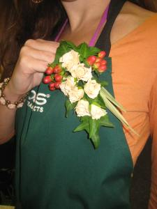 Traditional corsage with spray roses, hypericum berries, china grass and ivy
