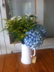 Hydrangea, Solidago & Chrysanthemums in a white jug at Windmills Cafe