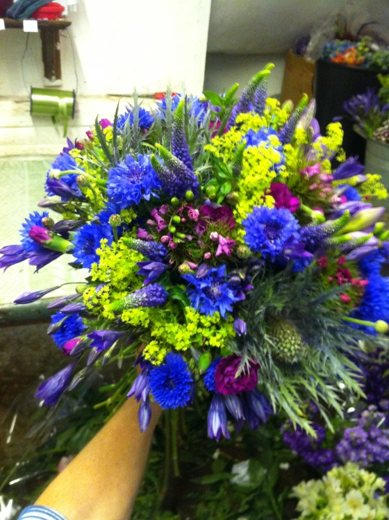 Hand tied with cornflower made at Bartleys