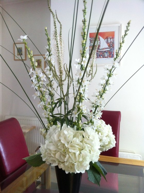 My all white dining table display with hydrangea, venronica & campanula